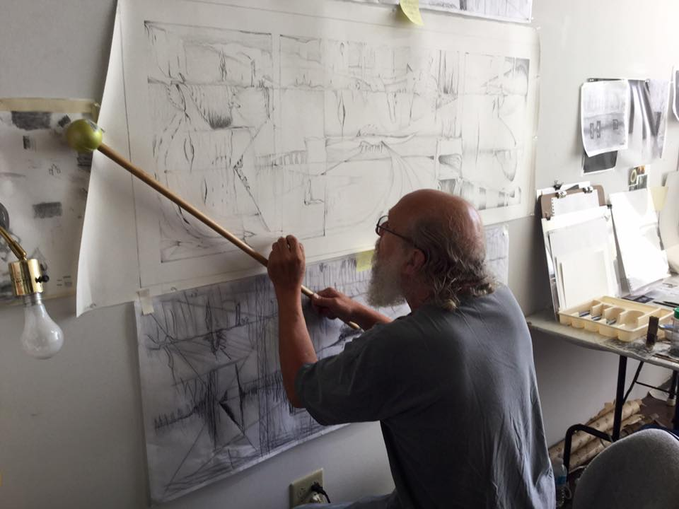 """Dave Becker demonstrates """"an old sign painter's trick."""""""