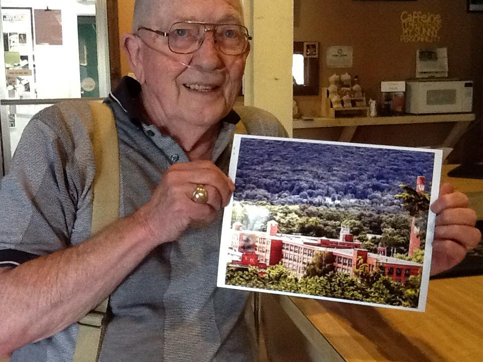 Dwain Gipe with a picture of the Pajama Factory