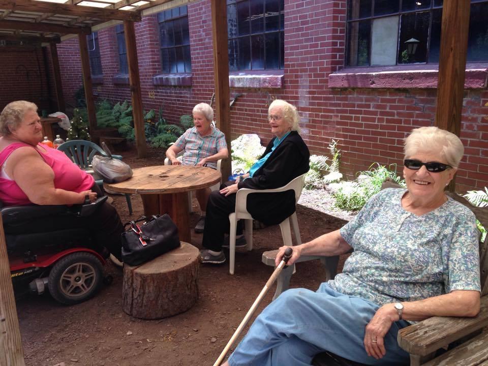 The Weldon Girls enjoy a reunion luncheon in the courtyard.